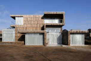 house fa 231 ade covered with recycled boards from wooden