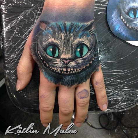 cheshire cat on s hand best tattoo design ideas