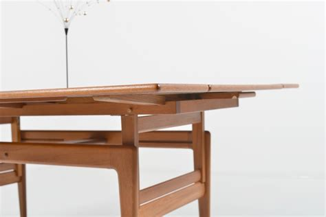 kristiansen sofa dining table in teak room of