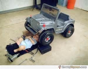 baby repairing a car