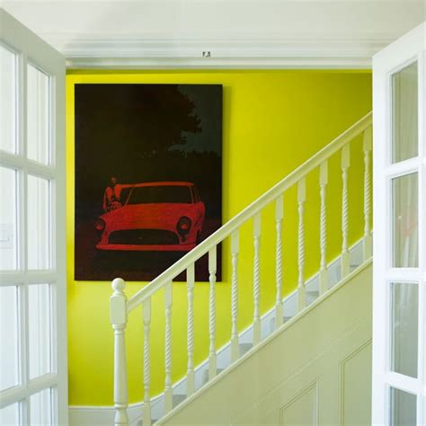 hallway with acid yellow feature wall yellow colour schemes home trends