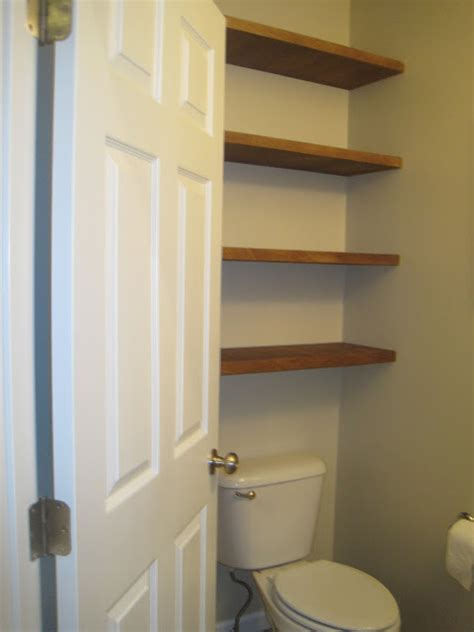 designed to dwell adding storage in a tiny bathroom