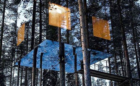 suspended swedish tree hotel reflects natural environment treehotel in sweden designer hotel in northern sweden