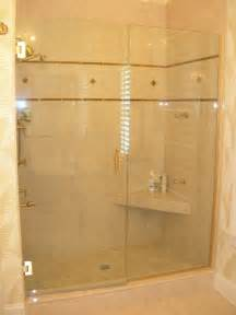 an sized shower stall with a corner seat and marble