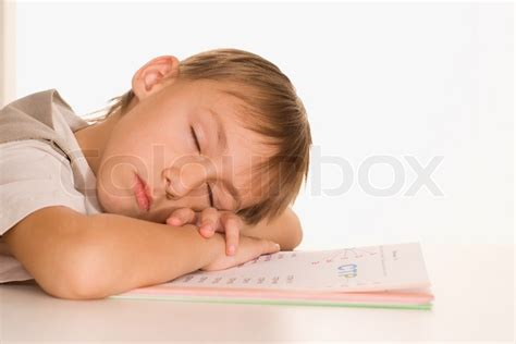 boy sleep on the table stock photo colourbox