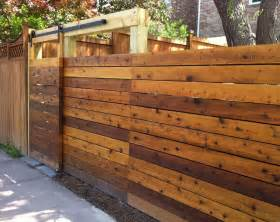 wood fence with sliding gate sliding door