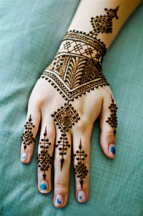 915 likes 6 comments melanie ooi awesome maple mehndi design for back hand fashion
