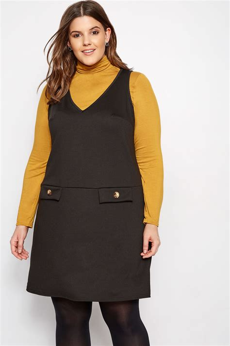 Pot Tawon No 27 plus size limited collection black button pinafore dress