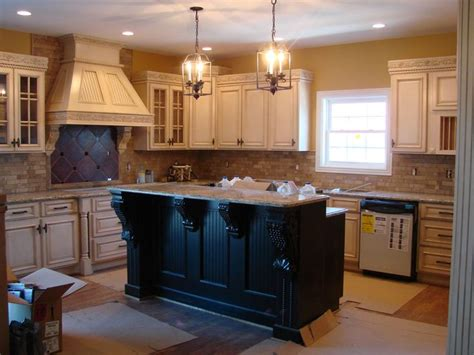 antiqued kitchen cabinets white glazed cabinets dark two tier island brick