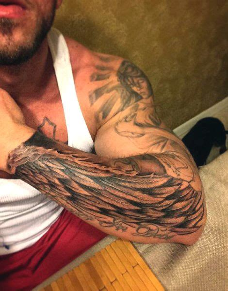 angel wing tattoos for men on arm forearm mens wing in black ink tatuajes