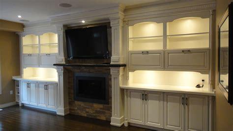 media cabinet near fireplace custom media room design hand crafted cabinetry custom