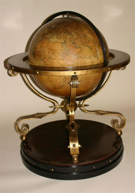 french globe of large dimensions on ebonized and gilded
