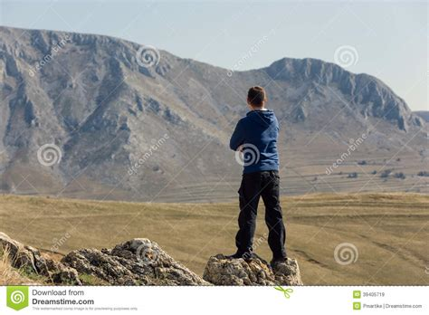 man standing on mountain top man standing on top of mountain stock photo image 39405719