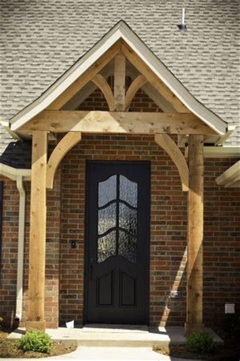 Double Front Porch House Plans Black Front Door Natural Cedar Beams Beacon Exteriors