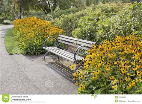 black park bench park bench with black eyed susan flowers stock photo