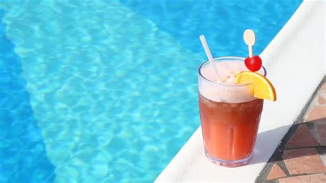 pool cocktail summer drink with umbrella by the swimming pool stock