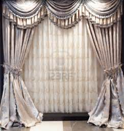 Photo luxurious old fashioned designer window curtains with flowers