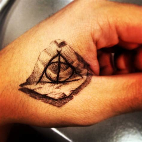 pen tattoo finger deathly hallows tattoo pen by sl3dbeans on deviantart