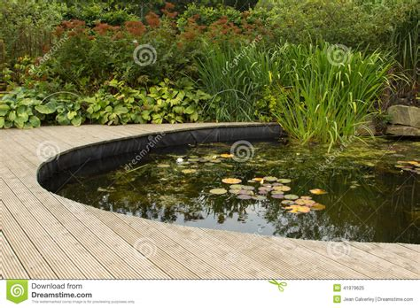 garden pond with decking stock photo image 41979625