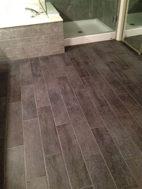 Bathroom floor  6x24 tiles charcoal gray. Look like wood