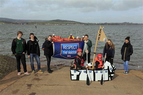 cardboard lifeboat exmouth rnli volunteers assist students cardboard boat