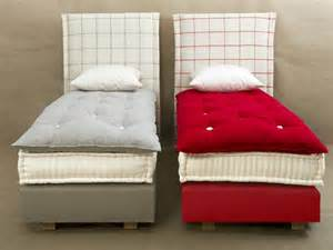 upholstered bed with high headboard by le lit national
