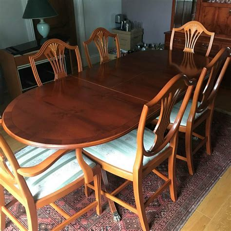 yew wood extending dining table  chairs  large wall