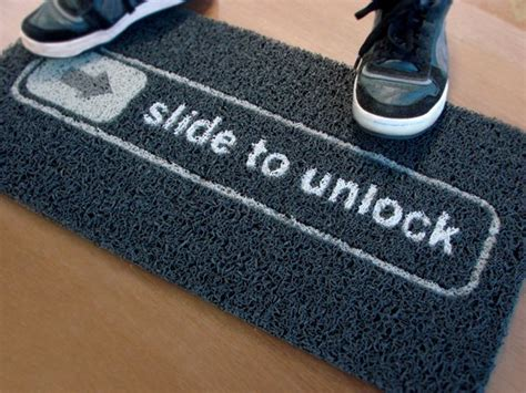 the apple fan doormat the slide to unlock mat
