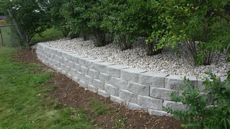 Low Maintenance Backyard Landscaping Pictures Retaining Wall Solutions Solving Problems For Hilly And