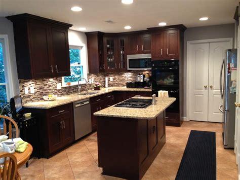 Paint For Laminate Kitchen Cabinets dark maple cabinets w medium granite and luxury vinyl