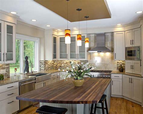 kitchen remodel butcherblock island cabinets white glass