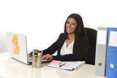 At T Corporate Help Desk by Happy Businesswoman Sitting At Computer Desk Stock Image