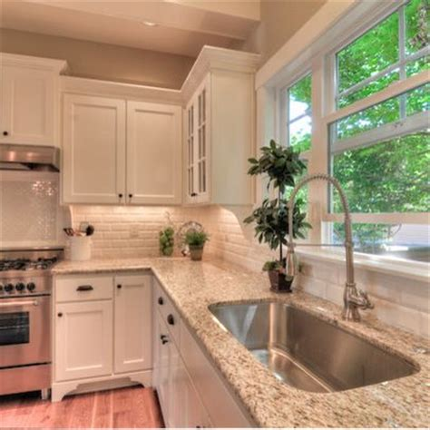 Giallo Ornamental Light Granite White Cabinets by Giallo Ornamental Granite Beveled White Subway Tile Back