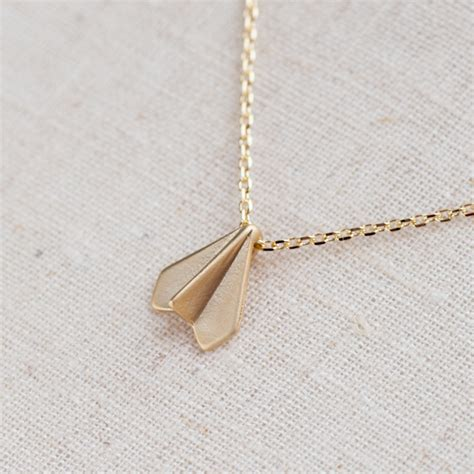 paper airplane necklace in gold on luulla