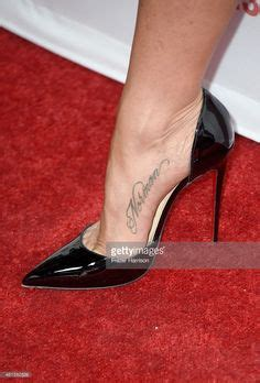jennifer aniston tattoo selena gomez shows some skin new while