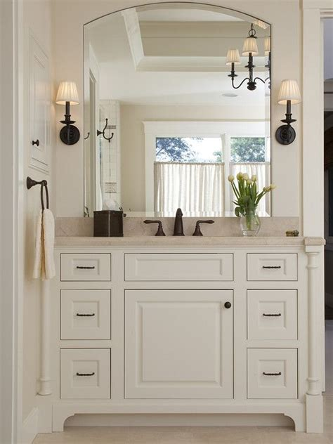 clean recessed vanity with sconce lighting for guest