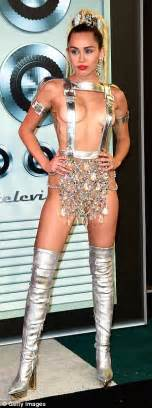 Pink Plastic Chandelier Mtv Vmas Hostess Miley Cyrus Causes A Stir With 11 Eyebrow