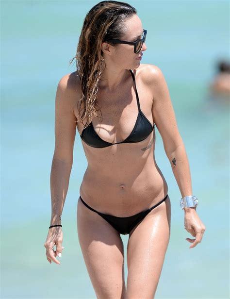 Catt Sadler Wears A Tiny Black Bikini On The Beach Pics
