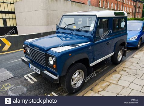 blue land rover blue land rover defender 90 county station wagon parked on
