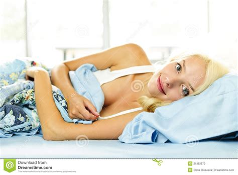 smiling laying in bed stock photo image 21382970