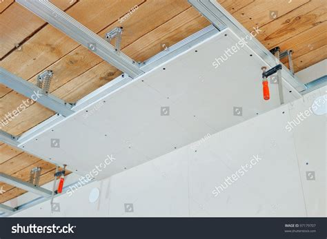 How To Install Gypsum Board Ceiling by Installation Of False Ceiling Of Gypsum Board Stock Photo
