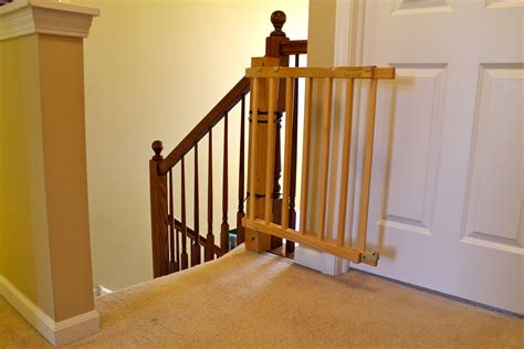 safety gate for top of stairs with banister safety stair gate bring mae flowers