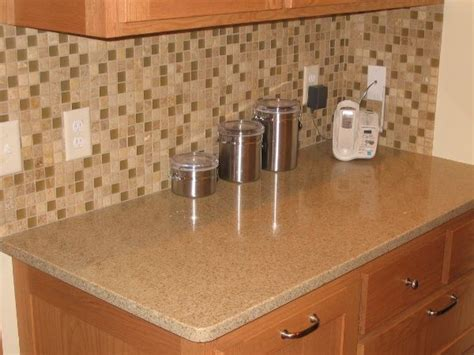 quartz countertops with light oak cabinets oak cabinets with quartz countertops search