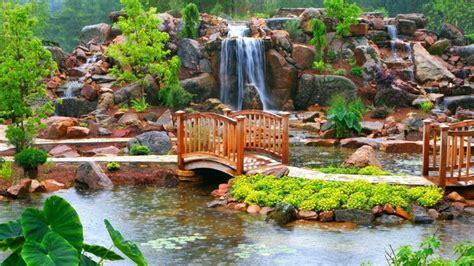 Bien Petit Pont Pour Bassin #1: cascade-bassin-jardin-rochers-plantes-aquatiques-pont-bois.jpg
