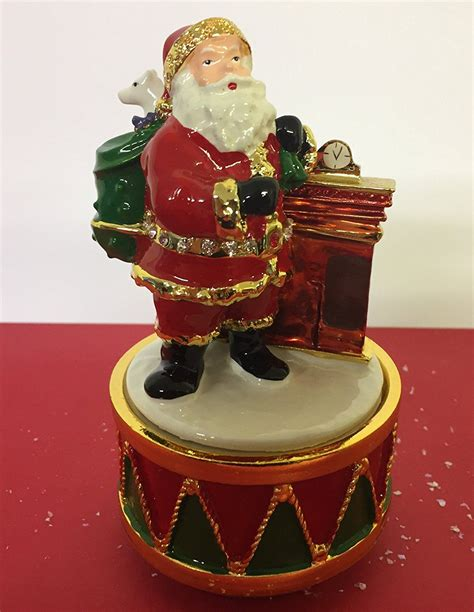 musical turning father christmas at chimney ornament plays