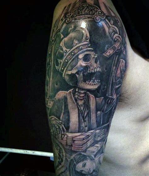 king tattoo on shoulder illustrative style colored shoulder tattoo of skeleton