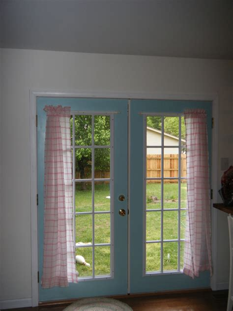 french doors with curtains vertical white black stripped curtains on the glass door