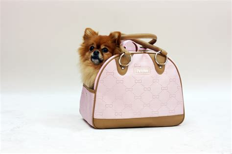 puppy in a purse carrying your pets style or comfort the pet product guru