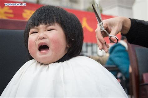 chinese children haircut children get haircuts for good luck on quot dragon lifting