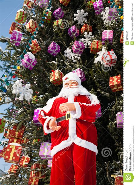 doll santa claus  christmas tree  snowfall royalty  stock photography image